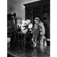 Nurse with little Albert standing on table