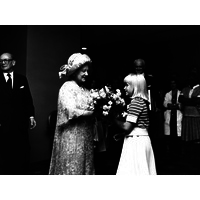 Queen Mother presented with bouquet by Annie Gautier Smith July 1978