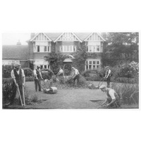 Colonists gardening outside Eleanor House