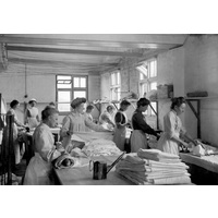 Colonists ironing in laundry c 1928
