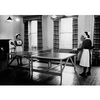 Two nurses playing table tennis